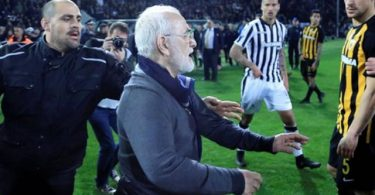 Shock as football club president invades pitch with gun