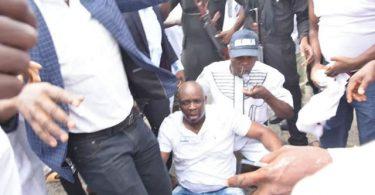 PHOTOSCENE: Police invade Ekiti govt House, Fayose tear gassed, faints