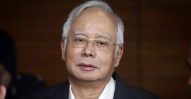 Former Malaysia PM slammed with money laundering charges