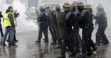 RISING FUEL TAX: French security forces fire tear gas, water cannons to disperse angry protesters
