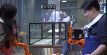 Researchers develop wearable robot arm that can feed you & your dinner companion