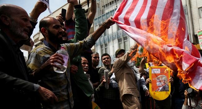 Iranians celebrate 40-yrs of Islamic revolution, burn US flags, chant death to Israel