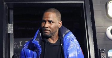 R Kelly surrenders to police after being charged for sexually abusing 4 girls