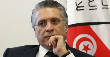 TUNISIA: Opposition candidate Karoui's supporters finger PM Chahed as mastermind of media mogul's arrest