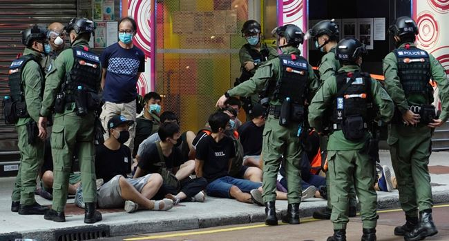 Hong Kong police arrest nine people suspected of helping residents detained by China