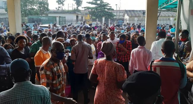 Lagosians ignore COVID-19 protocols, storm NIMC office in large number for NIN registration