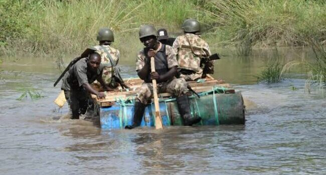 Nigerian soldiers on water